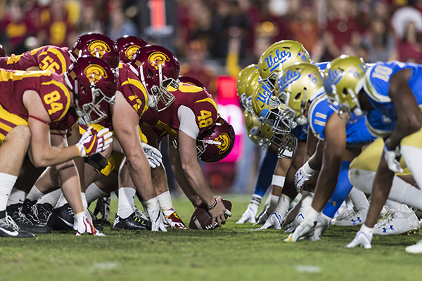 on sale e0d21 78efe USC Trojans offense and UCLA Bruins defense at the line of scrimmage before  a field goal attempt during an NCAA football game on Saturday, Nov.